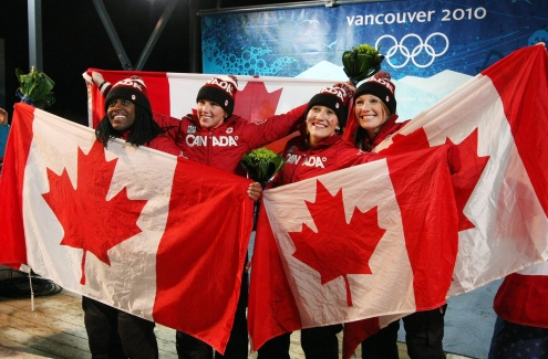 Kaillie Humphries and Heather of Canada celebrate their gold medal with teammates and silver medalists Helen Upperton and Shelley-Ann Brown during ladies 2 person bobsleigh at the 2010 Vancouver Olympic Winter Games in Whistler, B.C. THE (CANADIAN PRESS)2010(HO-COC-Dave Sandford)