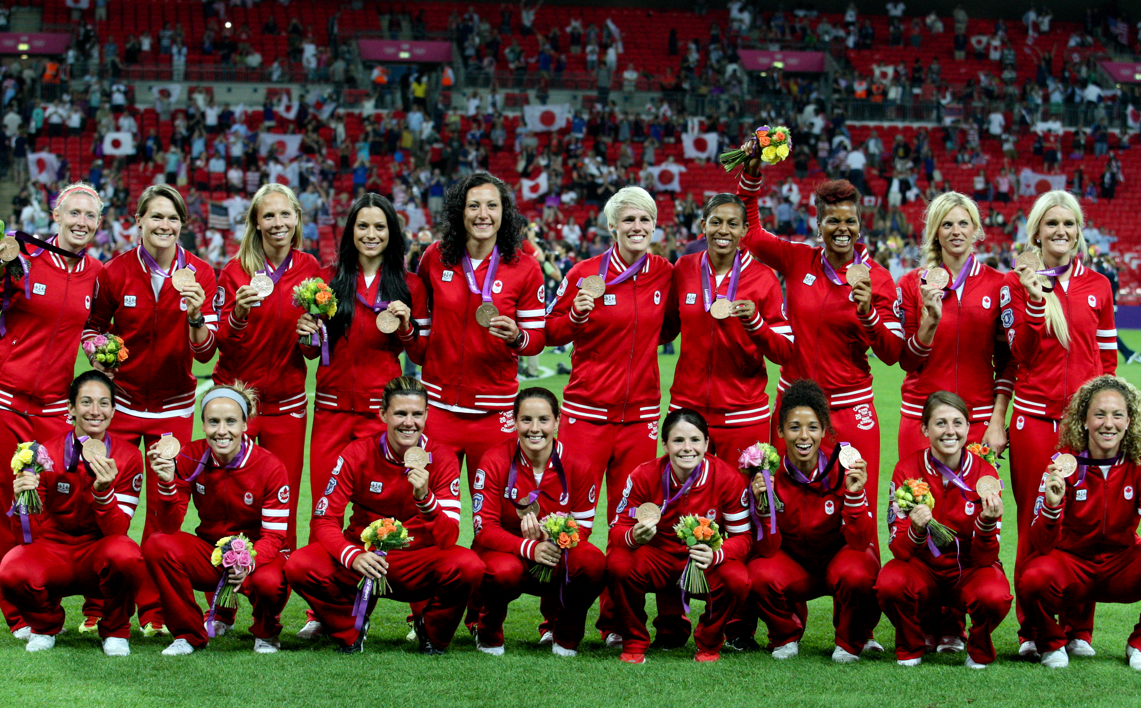 Canada's women's football team receive their bronze medals at Wembly Stadium at the 2012 London Olympics, Thursday, Aug. 9, 2012. THE CANADIAN PRESS/HO, COC - Mike Ridewood
