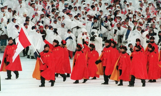 Canadian figure skater Kurt Browning carries the flag as he leads Olympic teammates onto the field during opening ceremony for the XVII Olympic Winter Games in Lillehammer Feb. 12, 1994. THE CANADIAN PRESS/Ron Poling