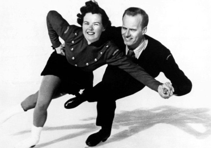 Black and white image of Frances Dafoe and Norris Bowden in competition Cortina D'Ampezzo Winter Olympics.