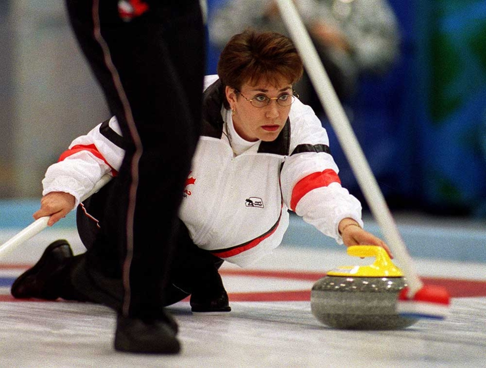 an athlete curling