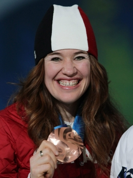 Women's 5000 metre long track speedskating bronze medalist Clara Hughes, of Canada, holds her medal during the medals ceremony at the 2010 Olympic Winter Games in Vancouver, B.C., on Wednesday February 24, 2010. THE CANADIAN PRESS/Darryl Dyck