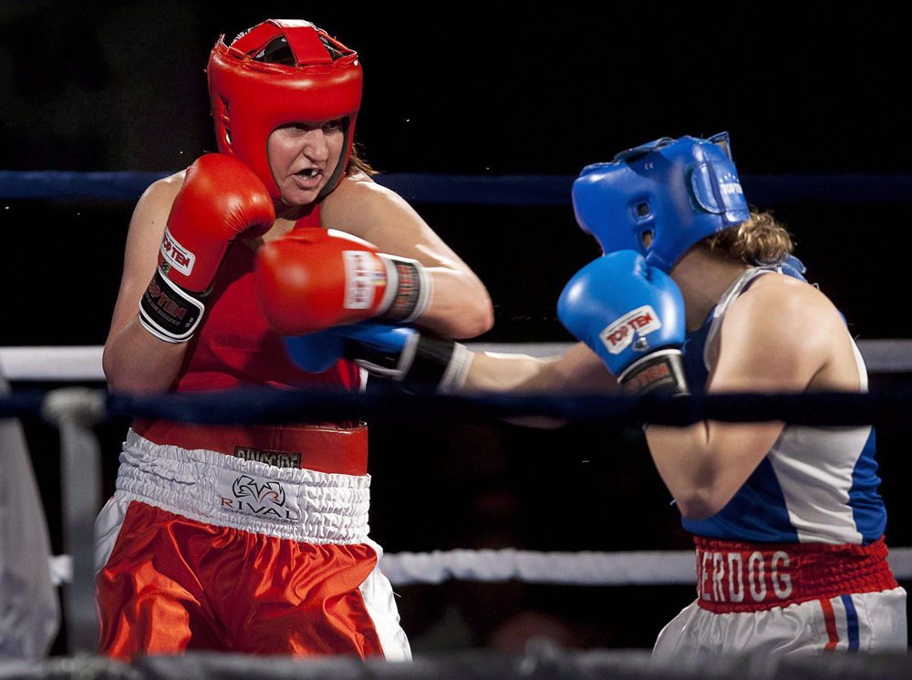 Boxer, Mary Spencer in the ring taking a punch