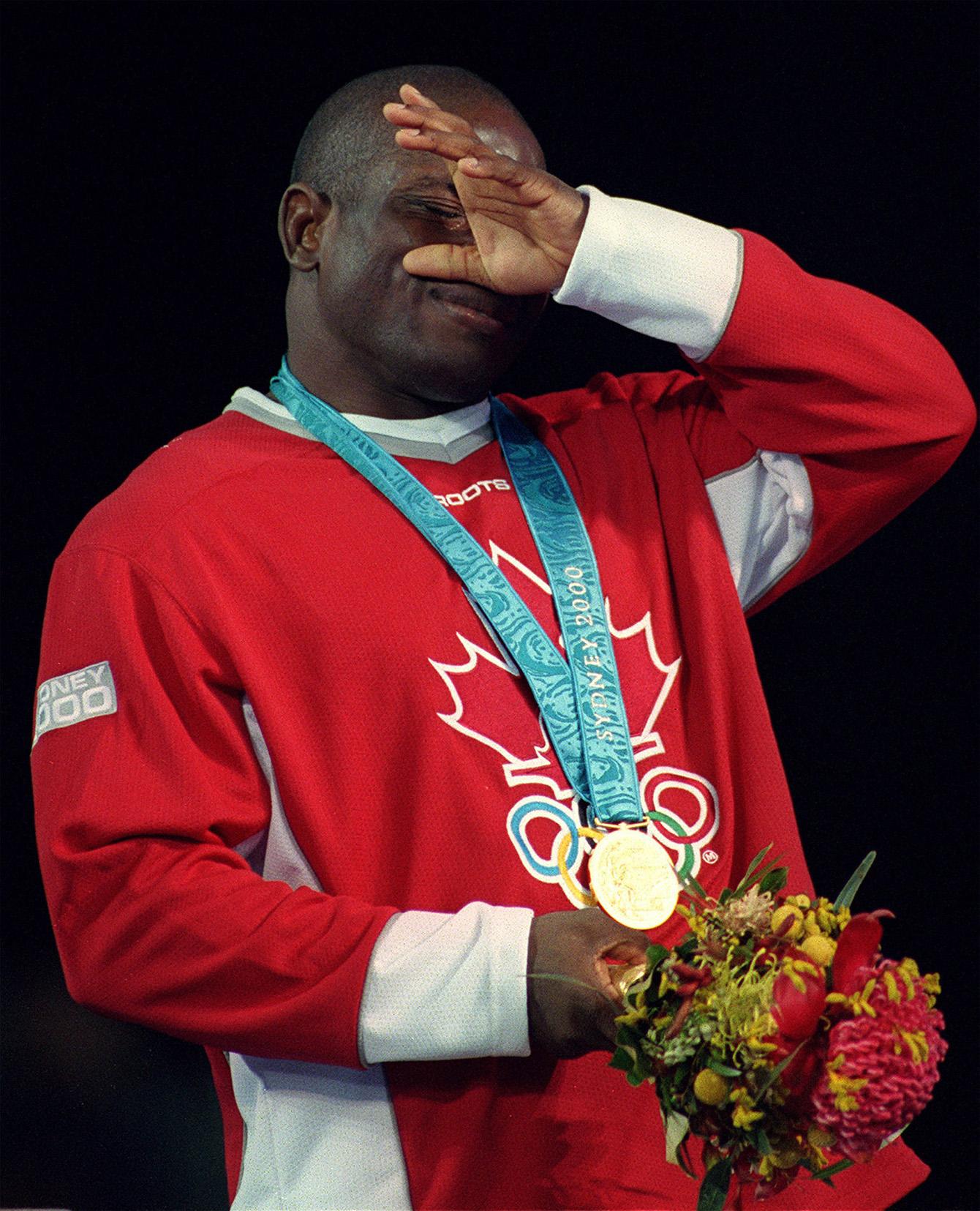 Igali wiping away tears on podium