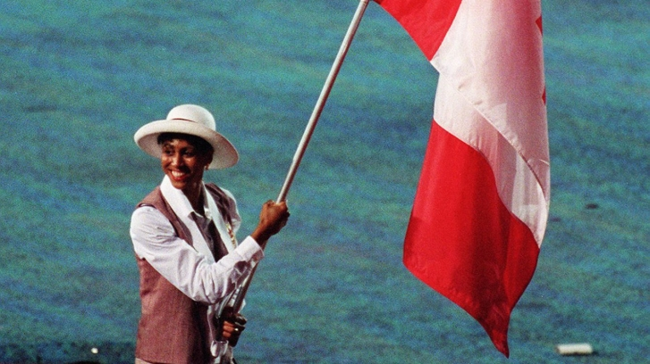 Canada's Charmaine Crooks carries the flag during the opening ceremony at the 1996 Atlanta Summer Olympic Games. (CP PHOTO/COC/Mike RIdewood)