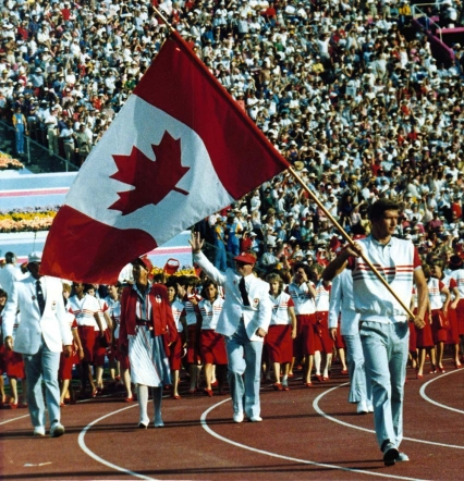 Alex Baumann leading the Canada as the Los Angeles 1984 Opening Ceremony flag bearer.