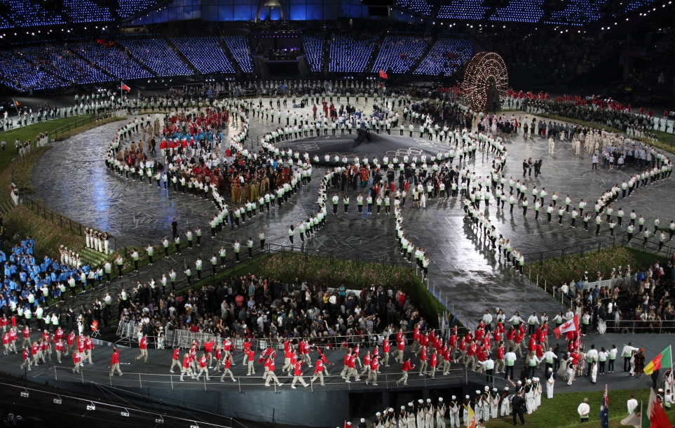 The Canadian Olympic team marches into the opening ceremony behind flag bearer Simon Whitfield at the 2012 London Olympics,