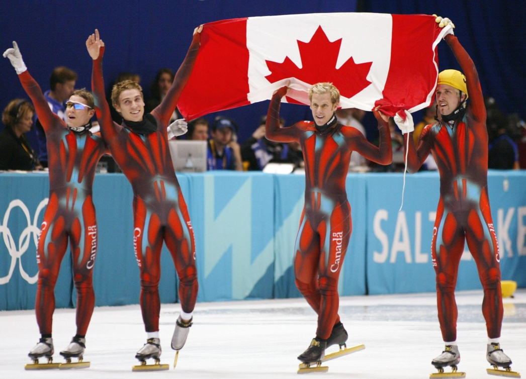 GUILMETTE-GAGNON-TURCOTTE-TREMBLAY celebrating with the Canadian flag