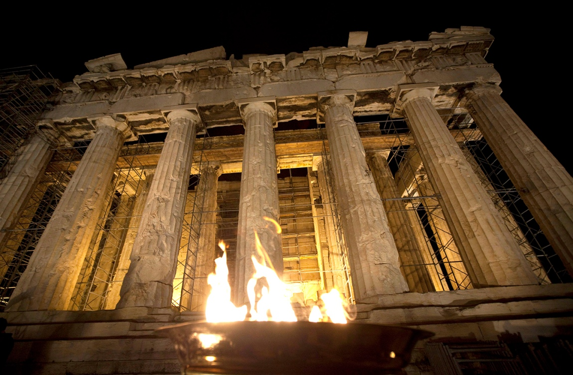 The Olympic Flame burns in a caldron outside the Parthenon on top of the Acropolis in Athens, Greece. Photo: The Canadian Press
