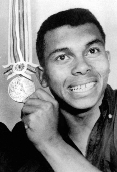 Jerome smiling with his bronze medal