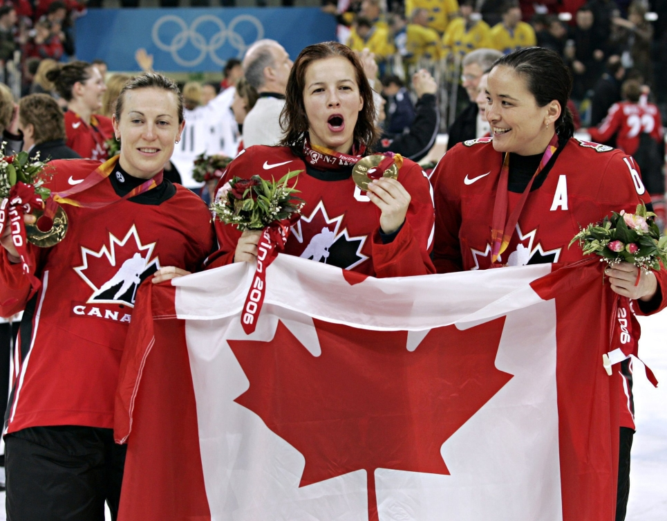 Jayna Hefford, Cassie Campbell, and Vicky Sunohara celebrate gold medal at Turin 2006