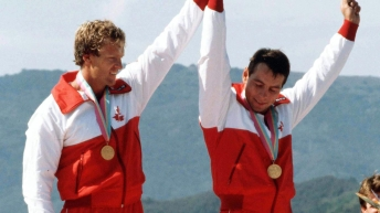 Pair holding hands as they win gold