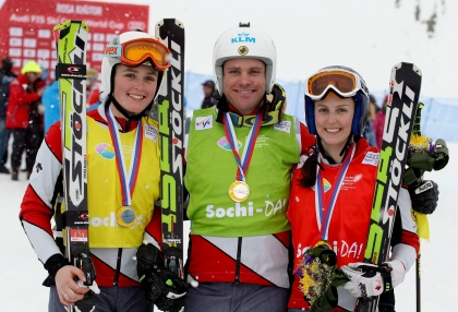 Serwa, right, celebrates her World Cup gold with Thompson, left, and their teammate Chris Del Bosco (Photo: CP)