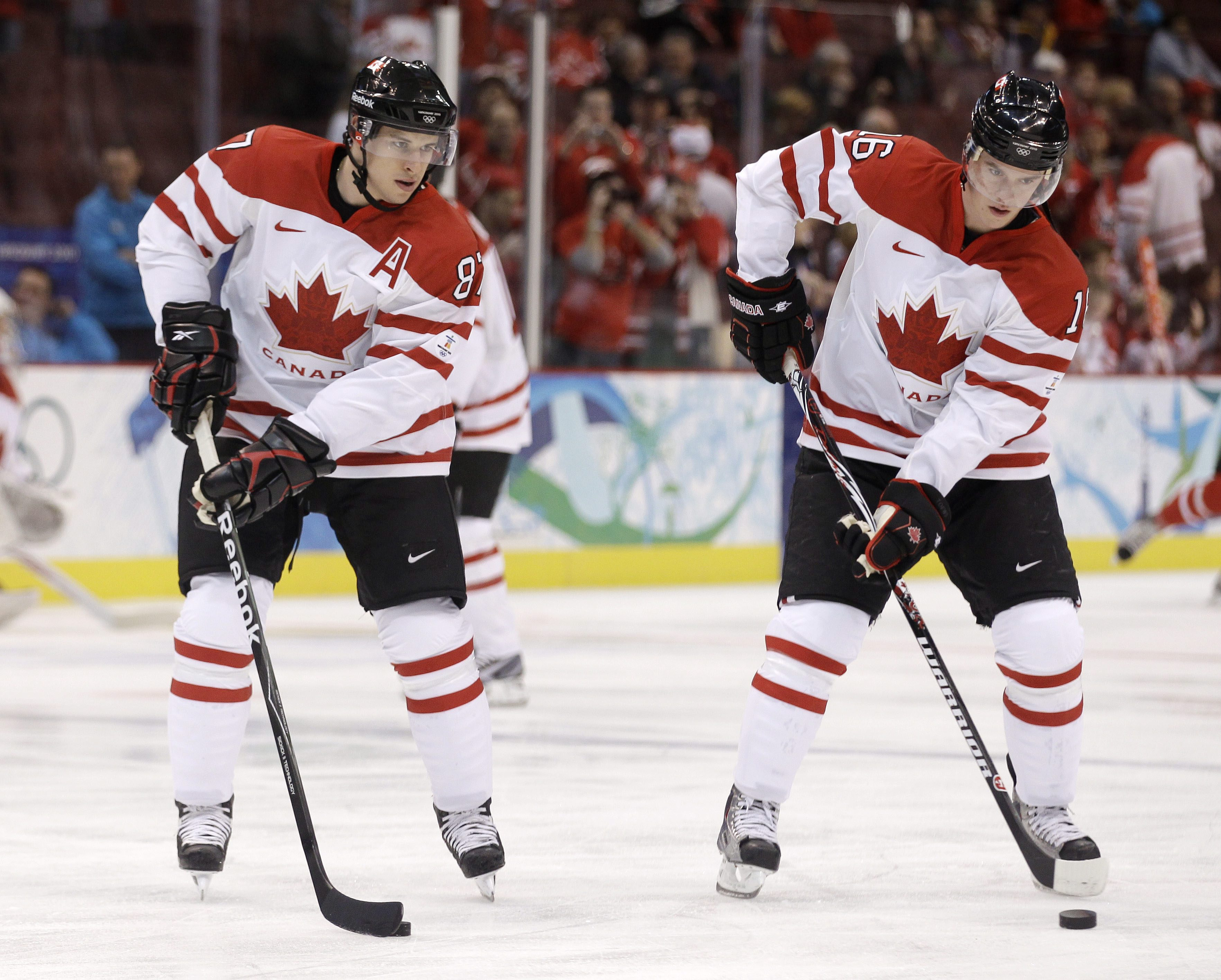 Sidney Crosby and Jonathan Toews warming up on the ice