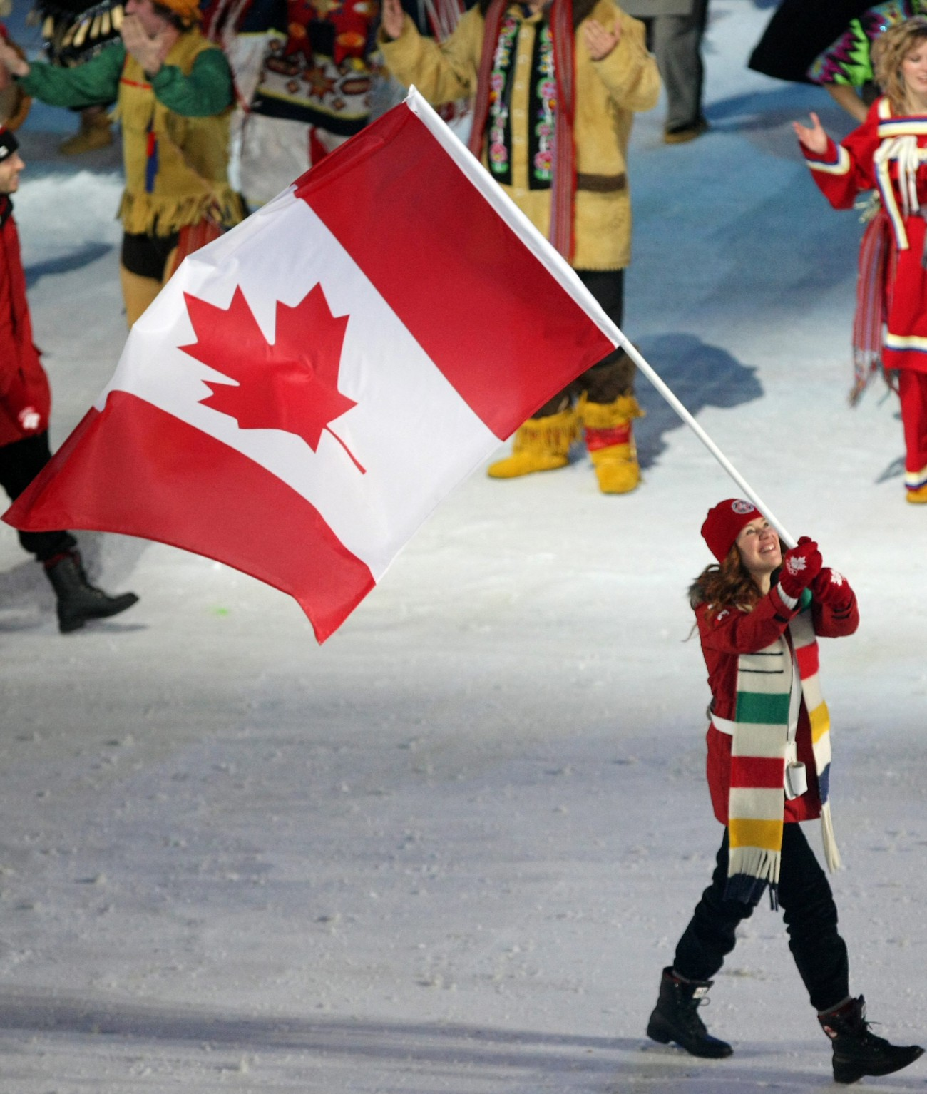 Clara Hughes carries the maple leaf into Vancouver 2010.
