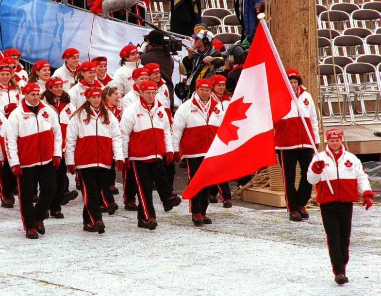 Canada's Jean-Luc Brassard carries the flag as the Canadian team participates in the opening ceremony at the 1998 Nagano Olympic Games.