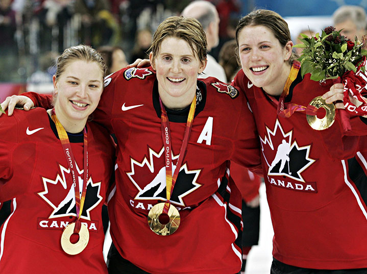 Team Canada's Colleen Sostrorics, left, Hayley Wickenheiser and Gillian Apps, right, celebrate after defeating Sweden 4-1 to win the gold medal in womens ice hockey at the 2006 Winter Olympic Monday, Feb. 20, 2006 in Turin. (CP PHOTO/Ryan Remiorz)