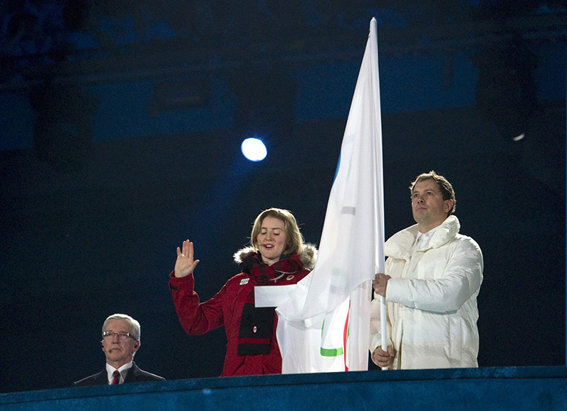 Canadian hockey player, Hayley Wickenheiser, takes the oath on behalf of all Olympic athletes at the Vancouver Olympic opening ceremonies Friday February, 12, 2010. THE CANADIAN PRESS/Darryl Dyck