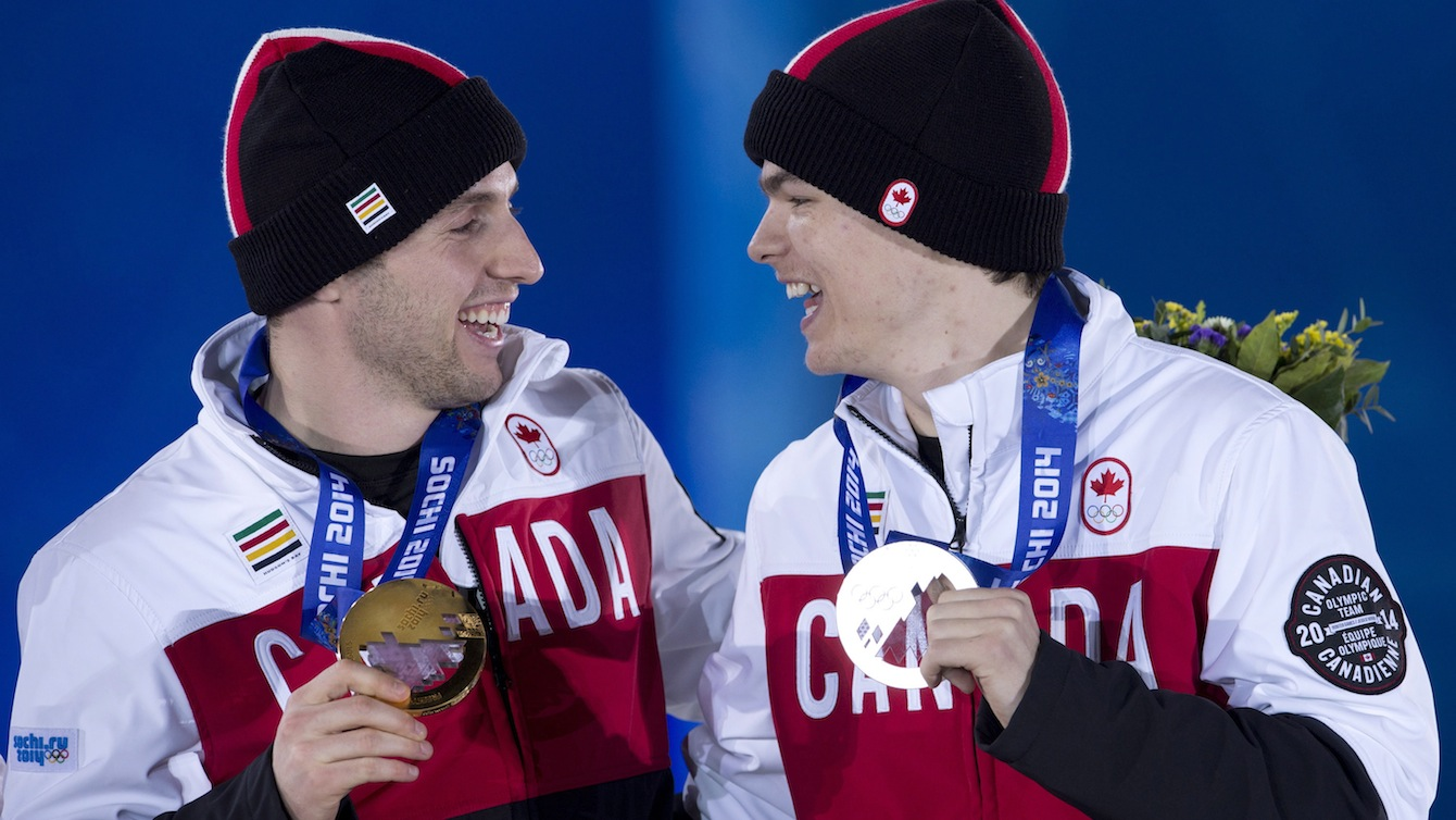 Alex Bilodeau (left) and Mikaël Kingsbury celebrate their gold and silver moguls medals from Sochi 2014.