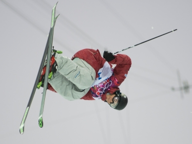 An athlete competing in ski halfpipe