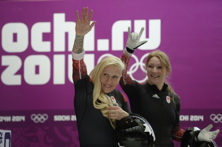 Kaillie Humphries and Heather Moyse waving