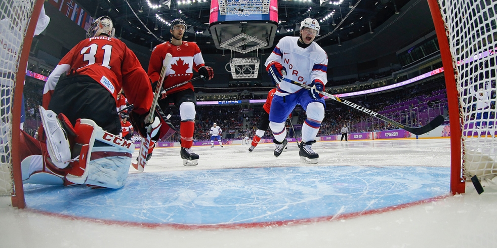 Norway forward Per-Age Skroder (19) reacts as the puck crosses the goal line against Canada in the third period of a men's ice hockey game against Canada at the 2014 Winter Olympics,Thursday, Feb. 13, 2014, in Sochi, Russia. Canada won 3-1. (AP Photo/Julio Cortez, Pool)