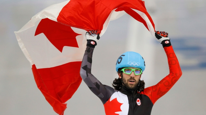 Charles Hamelin celebrating with flag