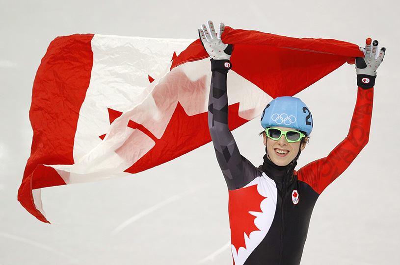 Charle Cournoyer of Canada celebrates his third place finish