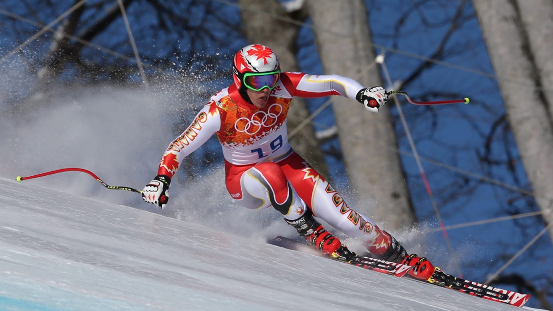 Guay on a huge lean while skiiing downhill