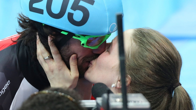 Charles Hamelin with a kiss for Marianne St-Gelais after his victory.