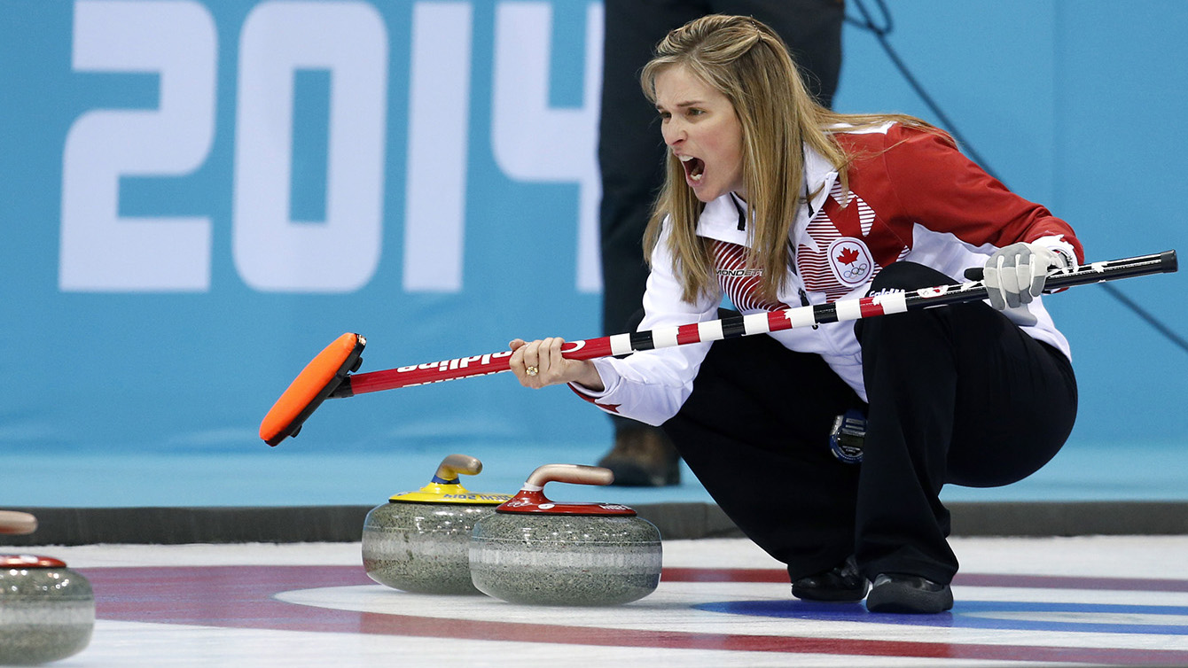 Jennifer Jones calls a shot while crouched in the rings