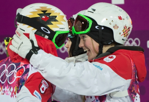 The Dufour-Lapointe sisters celebrate their medal victories.