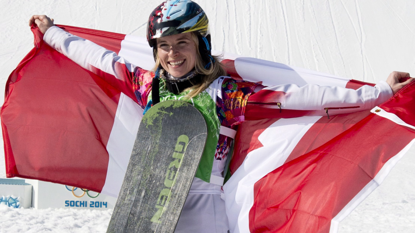 Dominique Maltais poses with Canadian flag