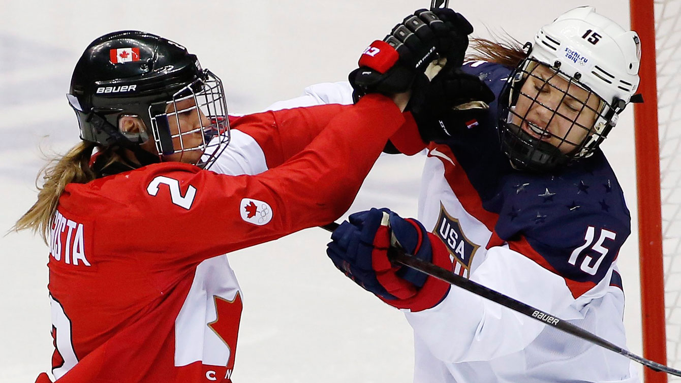 Meghan Agosta-Marciano and Anne Schleper mix it up during the women's gold medal match at Sochi 2014 (AP Photo/Petr David Josek)