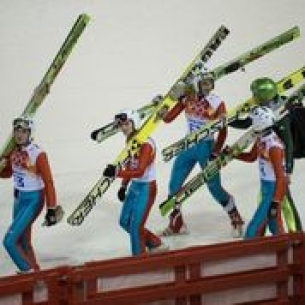 Athletes carrying their skis