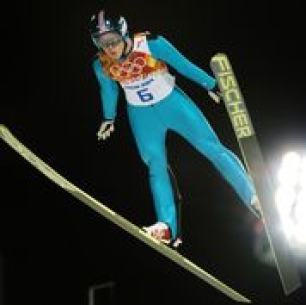 An athlete competing in ski jump