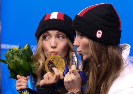 Justine Dufour-Lapointe receives her gold medal and her sister Chloe a silver