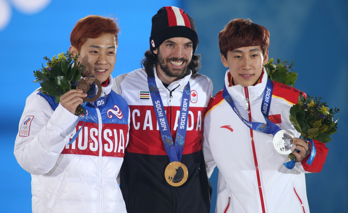 Charles Hamelin receives his gold medal in men's 1500 metre short track