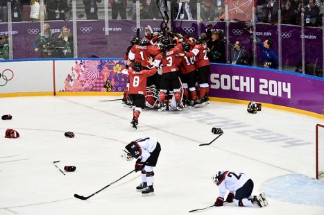 Team Canada celebrates beating Team USA in the gold medal women's hockey match