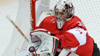 Canada goaltender Carey Price stops a shot on goal by Norway in the first period of a men's ice hockey game at the 2014 Winter Olympics, Thursday, Feb. 13, 2014, in Sochi, Russia. (AP Photo/Mark Humphrey)