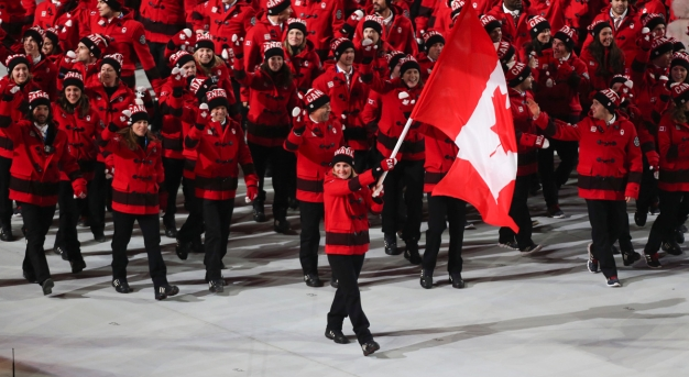 Hayley Wickenheiser leads Team Canada into the opening ceremony of the Sochi 2014 Olympic Winter Games