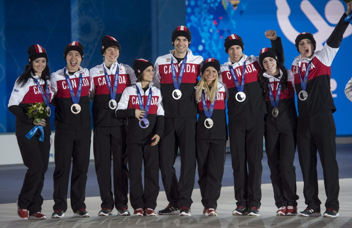 Team Canada posing for a picture with their medals