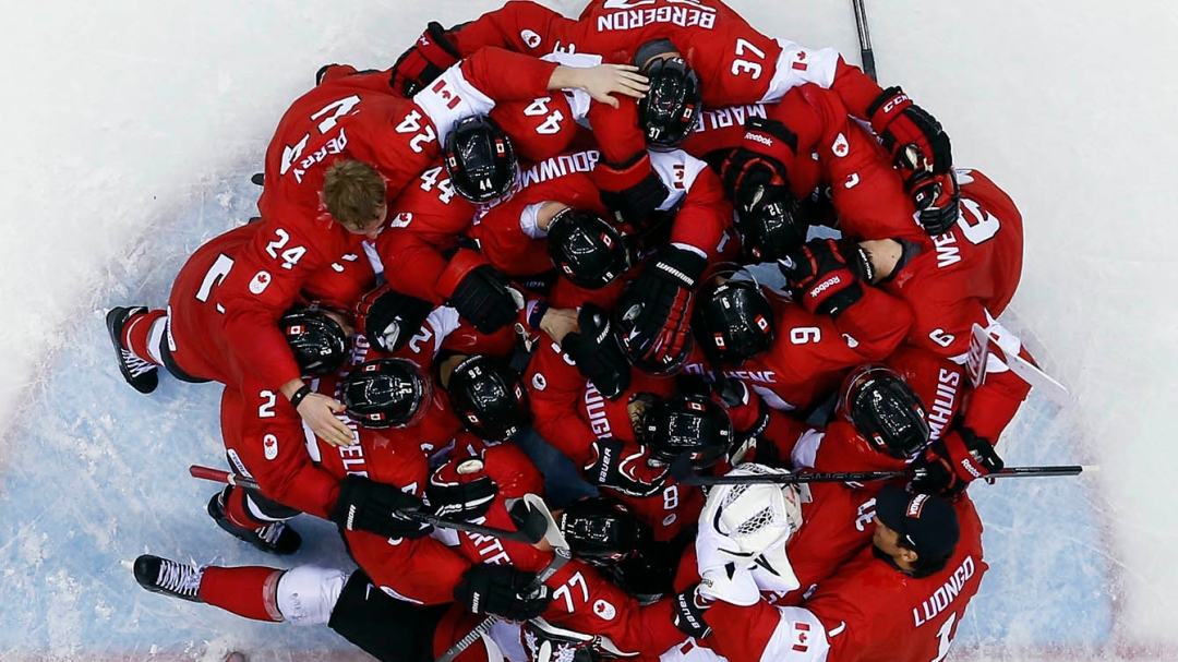 overhead view of hockey players huddled together