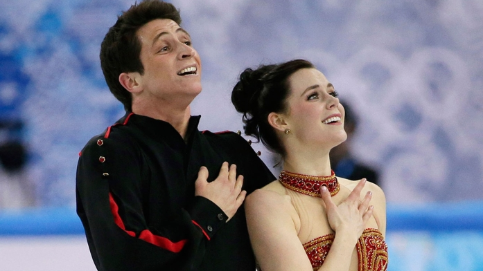 Tessa Virtue and Scott Moir compete in the free dance portion of the team event at Sochi 2014.