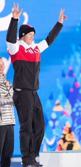 Mike Riddle receives the silver medal in men's ski halfpipe at the 2014 Sochi Winter Olympics