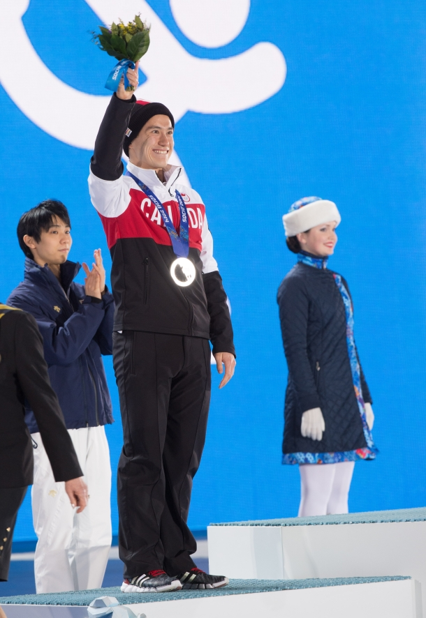 Patrick Chan receives his silver medal
