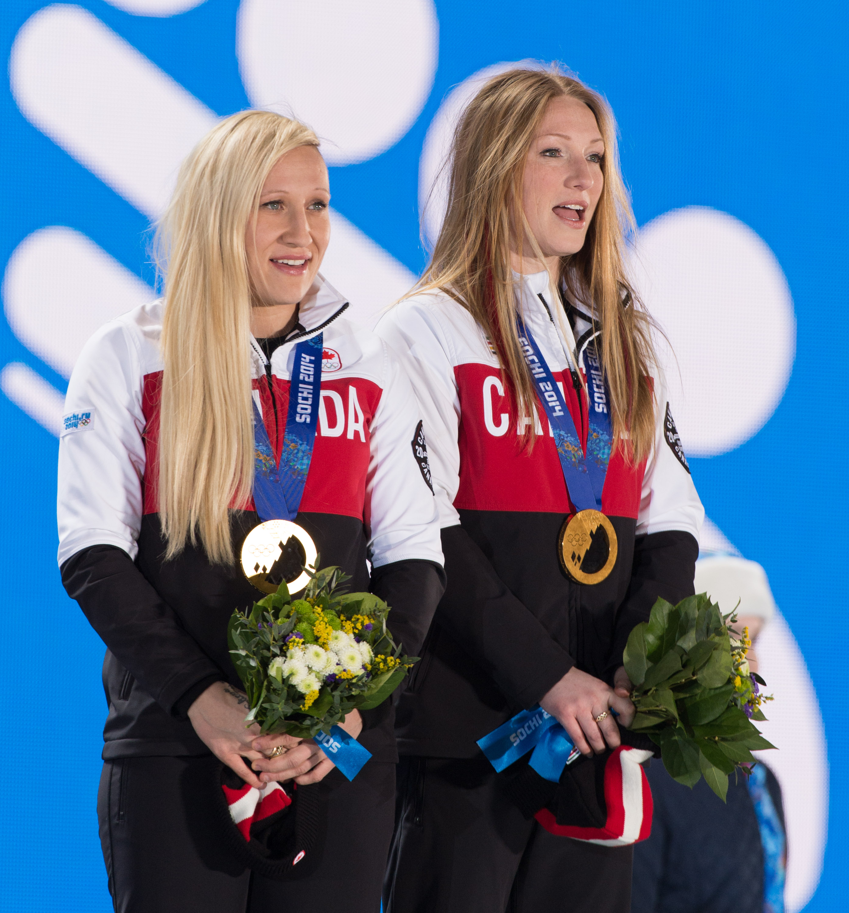 Kaillie Humphries and Heather Moyse receive their Sochi 2014 Olympic gold medals.