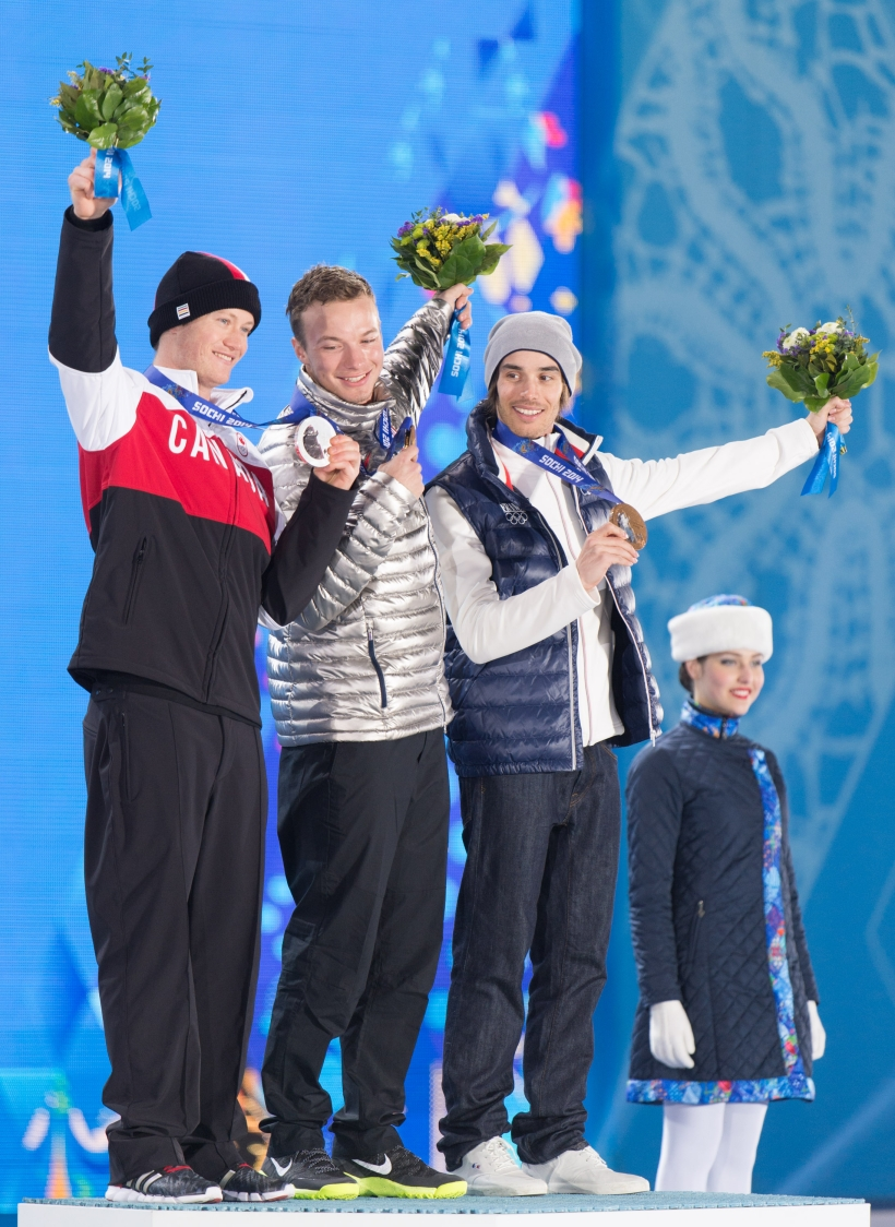 Mike Riddle poses with the other medallists