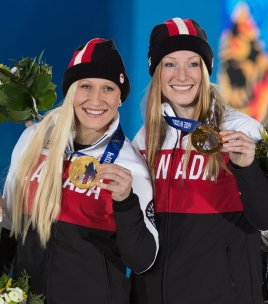 Kaillie Humphries and Heather Moyse posing with their medals