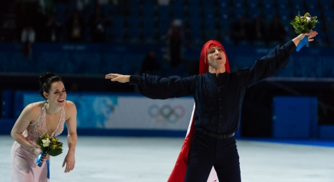 Scott celebrating with the Canadian flag over his head